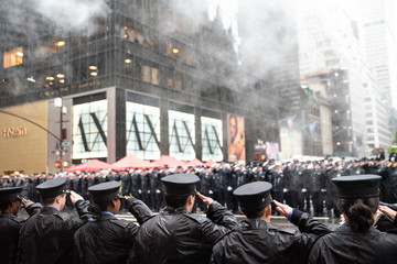 Thousands of firefighters line 5th Avenue in the rain to honor the life of a NYFD veteran who was killed in action.