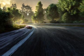 Fototapete - Rennstrecke im Sonnenuntergang mit Bewegungsunschärfe