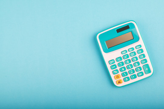 close-up and selective focus shot, calculator on blue background. copy space for text