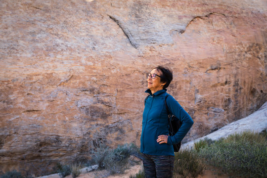 Portrait of a senior Asian woman in the desert rock landscape of Valley of Fire, Nevada, North America
