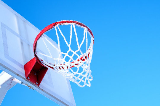 winter basketball in Russia blue sky and frozen ring