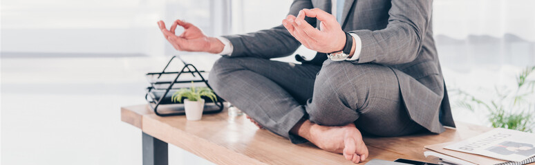 Recess Fitting Zen panoramic shot of businessman meditating in Lotus Pose on office desk