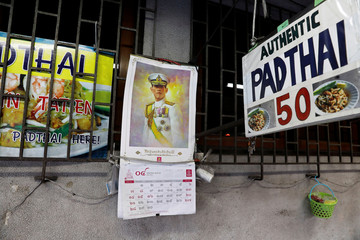 A picture of Thailand's King Maha Vajiralongkorn is seen in a food stall on the street ahead of his coronation in Bangkok
