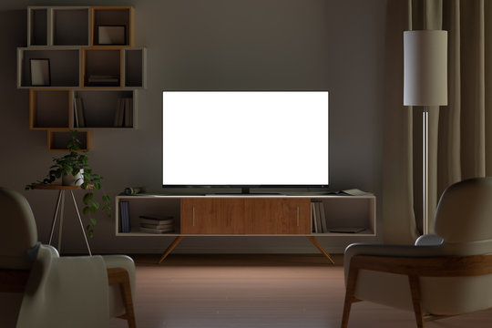 Tv mockup in living room at night. Tv screen, tv cabinet, chairs, bookshelf