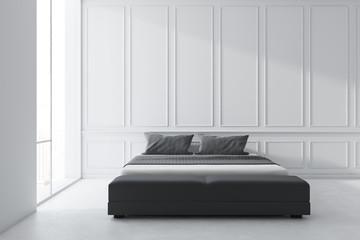 Minimalistic white bedroom interior