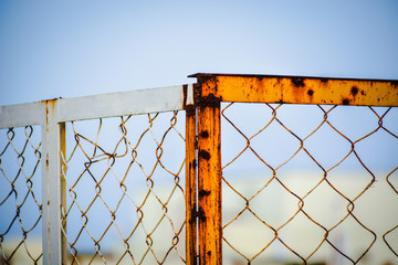 Rusty gate with blue sky background