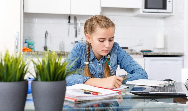 Girl doing herself her home task