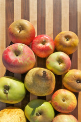 Heirloom Apples and Pears on butcher block cutting board