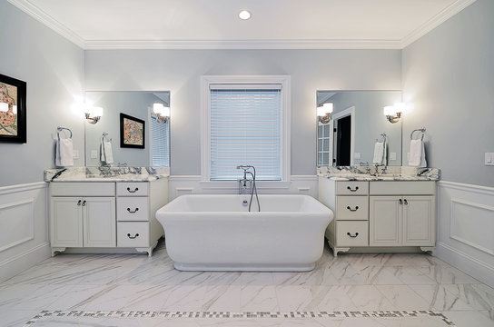 Master Bathroom with Freestanding Bathtub, Marble Sink Counter and Floor Tiles