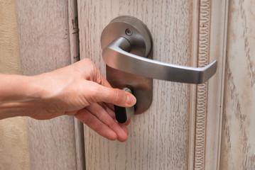 Woman closes door lock deadbolt