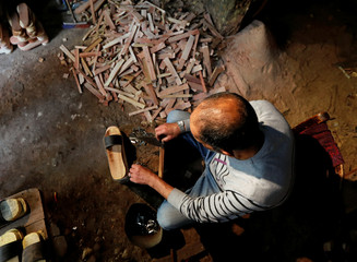 """An Egyptian artisan works on """"El Qobqab"""" at his workshop in old Cairo"""