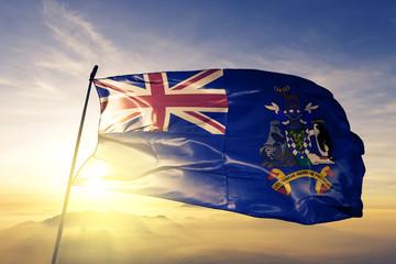 South Georgia and the South Sandwich Islands flag waving sunrise mist fog