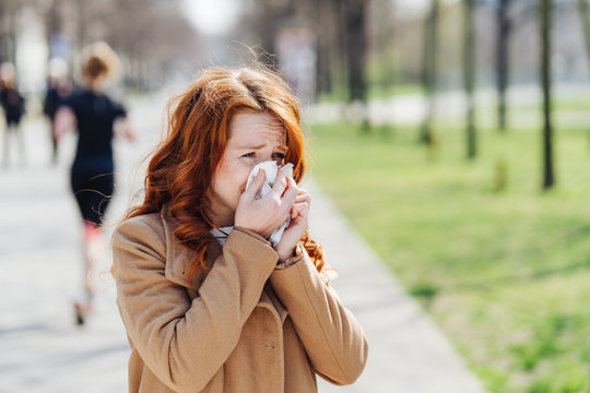 Young woman suffering from a pollen allergy