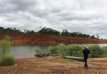 Australian Mines employee walks towards an old nickel mine that the company plans to restart as part of a plan to produce minerals for electric vehicle batteries in Greenvale