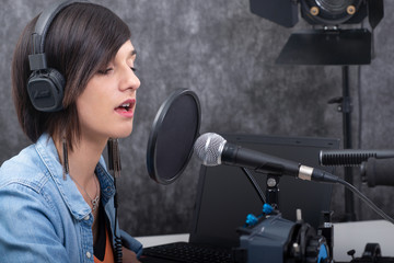 young woman working on the radio