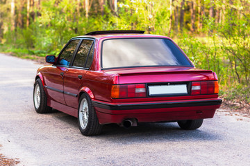 The rear of the old, red, German car