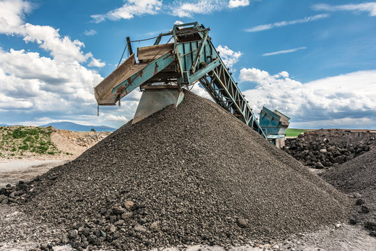 Recycling plant. Transforming asphalt from a gravel road to the construction of a new highway
