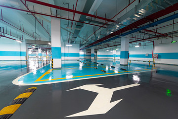 Fototapeta Underground parking and ceiling piping systems.