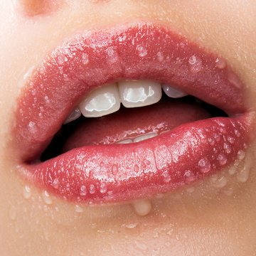 Beautiful lips with water drops close up