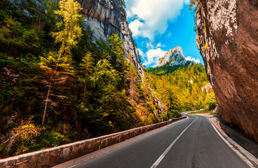majestic mountain scenery. road in mountains, glowing in sunlight. Romania- Carpathian Mountains. Bicaz Canyon Cheile Bicazului . Beauty in the world Fototapete