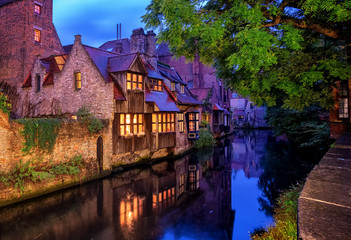 Wall Mural - Bruges Old Town, Belgium. Traditional medieval houses at night.