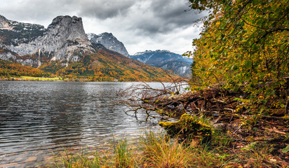 Wonderful Autumn landscape. Amazing Highmountain lake Grundsee and Mountain Backenstein on background. over the splendid Alpine Lake. Styria, Austria, Europe. Travels Conception. Picture of wild area.