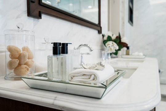 beautiful amenity hotel set on white marble counter in bathroomm
