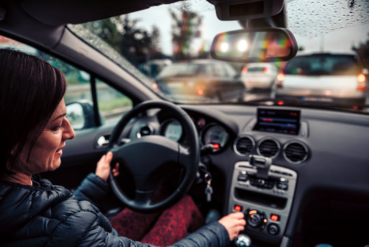 Woman stuck in a traffic jam listening radio