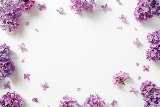 Decorative frame of beautiful purple lilac flowers.