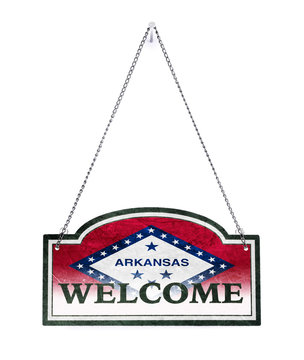 Arkansas welcomes you! Old metal sign isolated