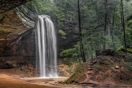 Hocking Hills Beauty - In the Hocking Hills of Ohio, a beautiful, tall, free-falling waterfall graces Ash Cave, an enormous recess cave with an overhanging cliff of Black Hand Sandstone.