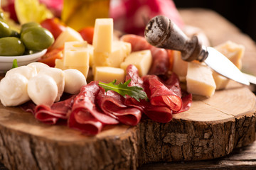 Antipasto catering platter with olives , jerky, salami and cheese