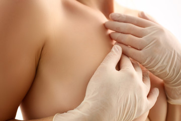 Naked Woman Examining Breasts Healthcare Portrait. Topless Female Checking Breast on White Background. Medical Bust Diagnostic with Hands in Gloves. Beautiful Body and Skin Partial View Shot