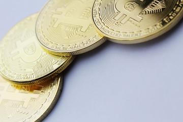 Golden bitcoin on white background high resolution photo