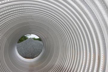 Aluminized Steel Pipe Focused Ahead on Gravel Road