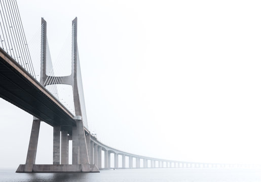 Ponte Vasco da Gama, Lisbon on a misty morning in March. Large concrete bridge across River Tagus, Portugal