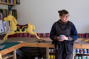 Smiling artist standing in workshop