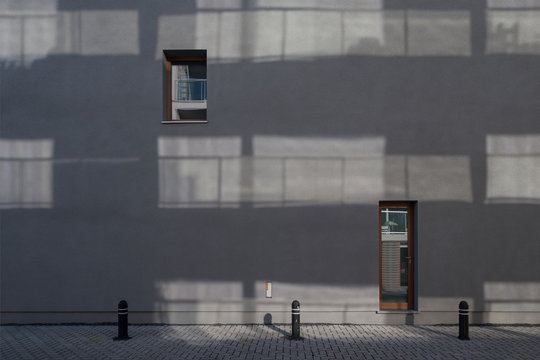 abstract wall with sparse windows of housing project