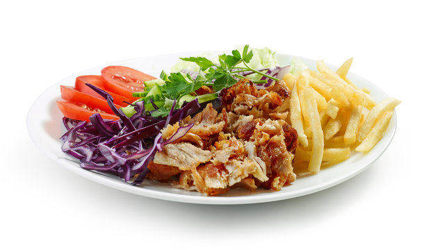 plate of chicken kebab and vegetables
