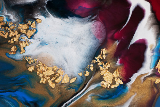 Resin art. Abstract painting. Acrylic pouring with the addition of gold foil.