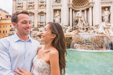 Wall Mural - Rome couple on romantic date by Trevi Fountain in Roma, Italy. Romantic luxury honeymoon Europe cruise travel tourists lovers traveling in european city. Asian woman falling in love with Italian man