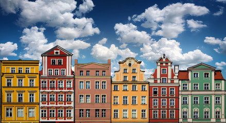 Colorful facades of historic buildings against the sky in the historic old town of Wroclaw, Poland. Architecture and historic background.