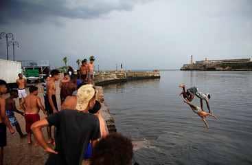 Children play at the seafront Malecon in Havana