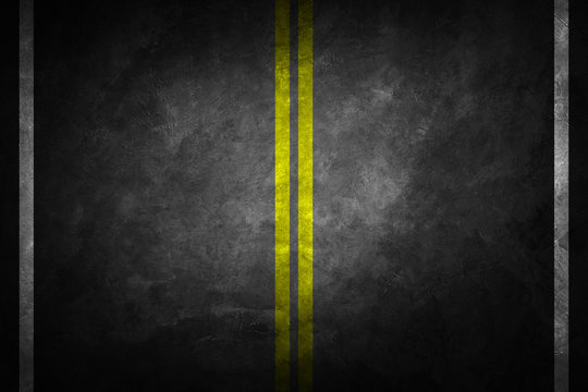 Structure of granular asphalt. Asphalt texture with two yellow line road marking. Abstract road background.
