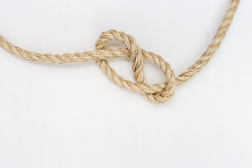 Rope knot onwhite background. Copy space.
