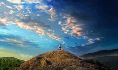 Serenity and yoga practicing at mountain range,meditation Wall mural