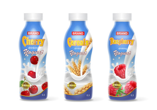 Drinking yogurt in bottles set with fruit and berries. Cherry, raspberry and cereals
