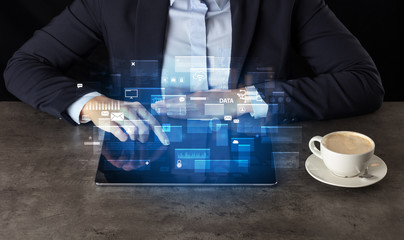 Business woman working on tablet with global database concept and dark background