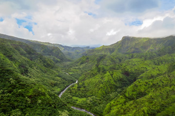 River meandering through green valley and mountain landscape, Na Pali Coast State Wilderness Park, Kauai, Hawaii, USA