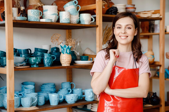 Young business woman workers on background of clay pottery store. Concept startup